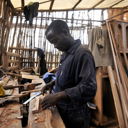 A reintegrated ex-militia member learning to become a carpenter in DR Congo.
