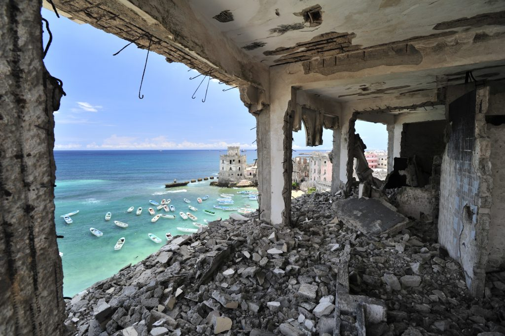 Once one of Mogadishu's most luxurious hotels, the Al-Uruba lays in ruins after two decades of civil war. Though building work in Mogadishu is on the rise, it may still be several years before many of the city's buildings will be restored. AU-UN IST PHOTO / TOBIN JONES.