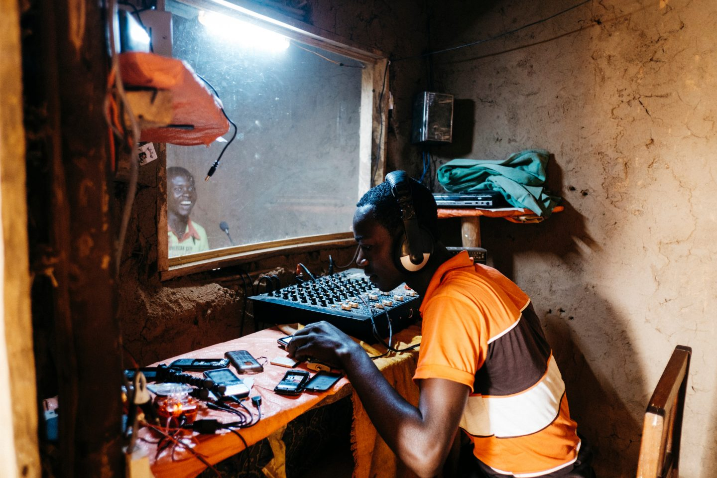 Nzanzu Nelson, 21, working at the Kabasha Community Development radio station in Beni, Democratic Republic of Congo. 5th July 2016. Photo by Greg Funnell